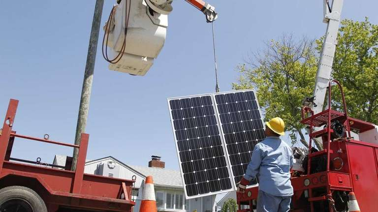 Crews work on installing Long Island's first solar