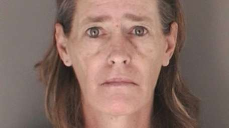 Judith McGlone, 50, of East Meadow, was charged
