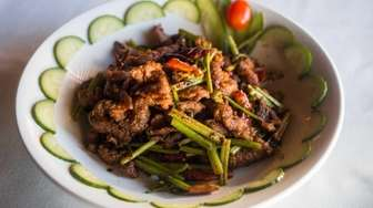 Fried cumin lamb is a Sichuan dish served