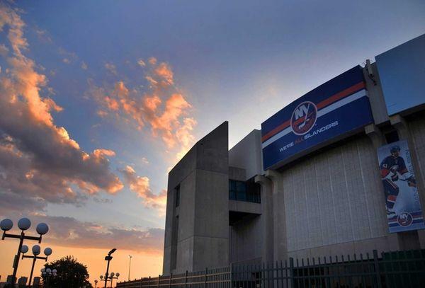 Exterior of Nassau Veterans Memorial Coliseum at sunset.