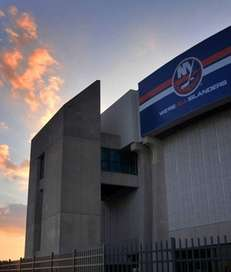 Exterior of Nassau Veterans Memorial Coliseum at sunset.
