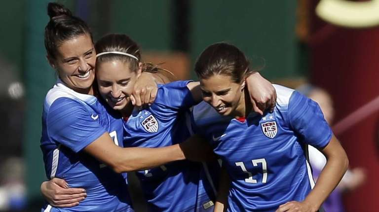 The United States' Morgan Brian, center, is congratulated