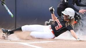 Babylon's Bridgette Rohl (20) slides safety into home