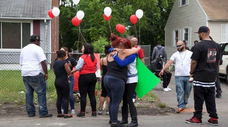 People gather on Davidson Avenue in Wyandanch on