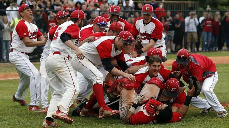 The Connetquot bench rushes catcher Stalem Baez and