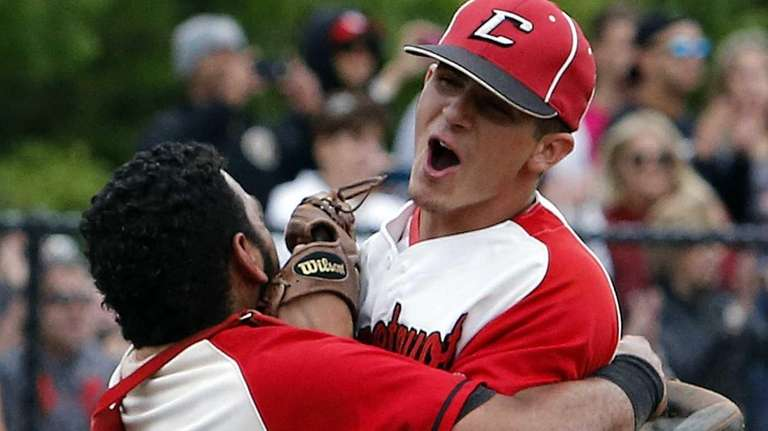 Connetquot catcher Stalem Baez (14) hugs Travis Bruinsma