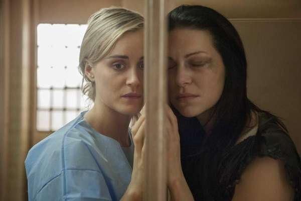 Taylor Schilling, left, and Laura Prepon in