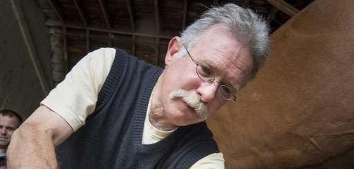 Blacksmith Joe Campbell puts shoes on Sun Worshiper