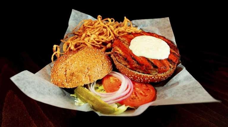 A Blazing Buffalo Chicken Burger is served with