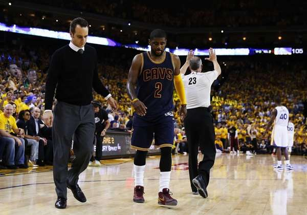 Kyrie Irving of the Cleveland Cavaliers leaves the