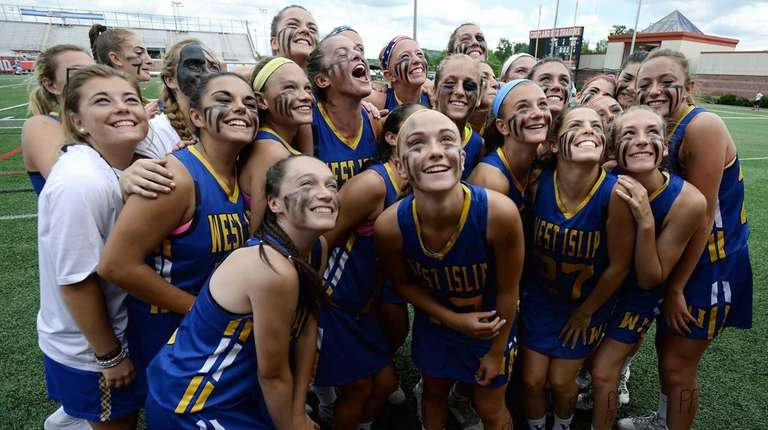 West Islip players pose for photos following their