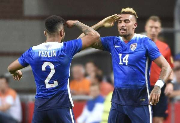 The United States' Danny Williams, right, celebrates with