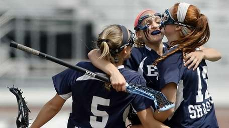 Eastport-South Manor's Kasey Choma, center, celebrates her goal