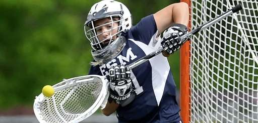Eastport-South Manor's Samantha Giacolone makes a save during