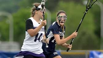 Eastport-South Manor's Corie Hack, right, defends against Watertown's