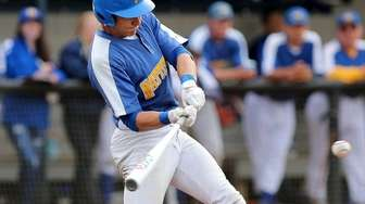 Mattituck's Will Gildersleeve lines a single to the