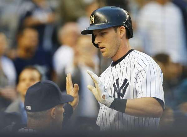 Stephen Drew of the Yankees celebrates his second-inning,