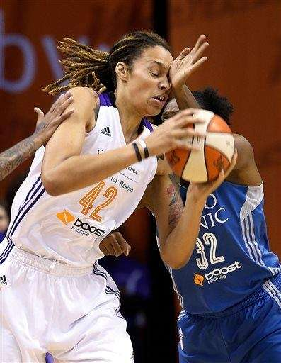 Phoenix Mercury's Brittney Griner (42) gets hit in