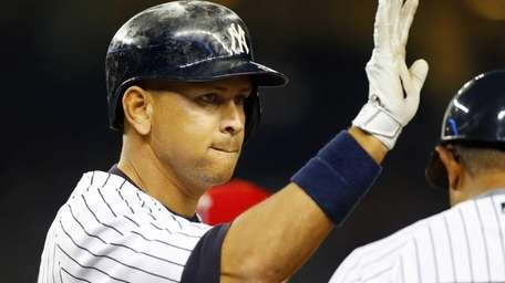 Alex Rodriguez of the Yankees reacts after his