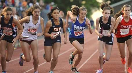 The girls 4x800 meter relay gets underway at