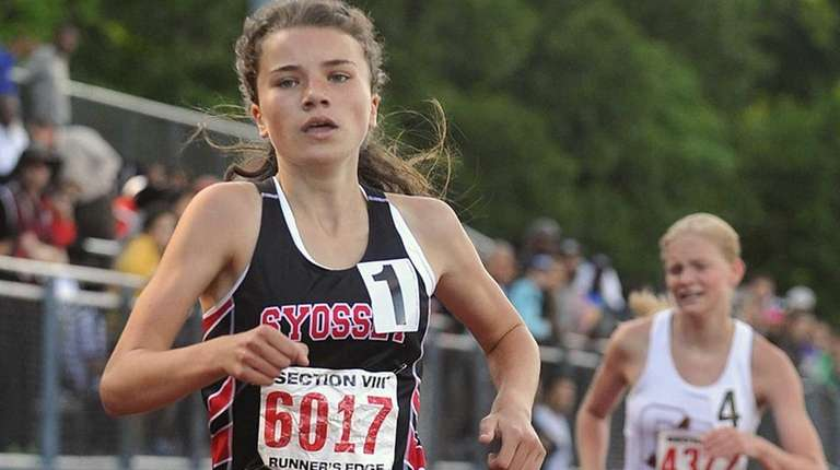 Reilly Siebert of Syosset legs out a victory