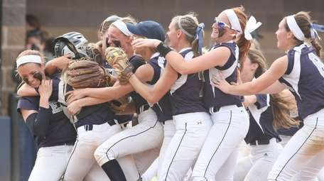 Eastport-South Manor players celebrate their win during the