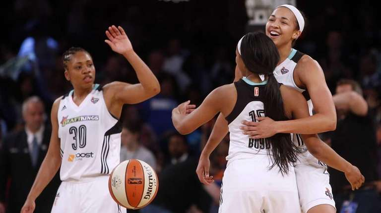 New York Liberty's Brittany Boyd celebrates with teammates