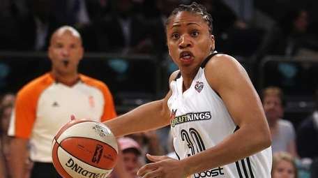 New York Liberty's Tanisha Wright drives against the