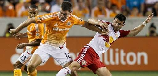 Houston Dynamo forward Will Bruin keeps the ball
