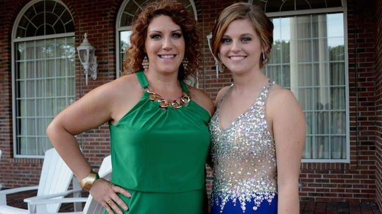 Kayla D'Addario, right, who studies cosmetology at William