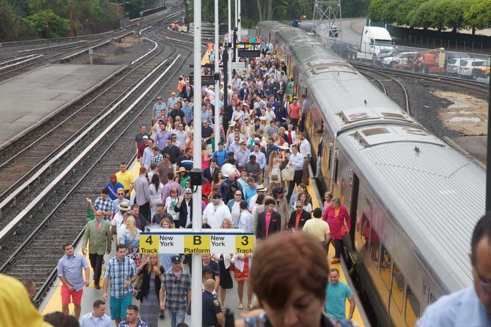 People arrive from the Long Island Rail Road