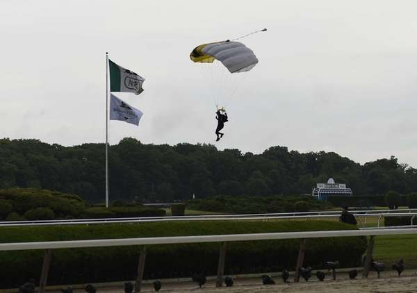 A member of the Army Black Knights parachute