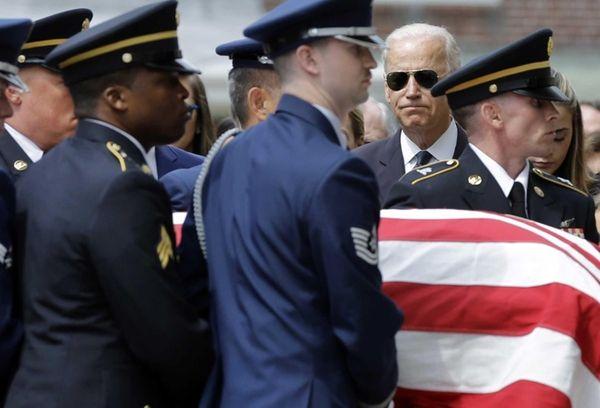 Vice President Joe Biden watches an honor guard