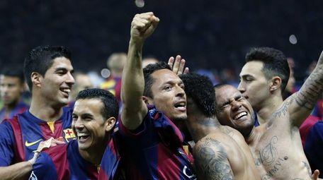 Barelona players celebrate after winning the Champions League