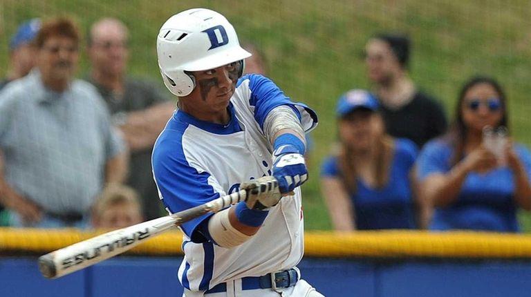 Division Avenue third baseman Ronmel Ocampo plates a