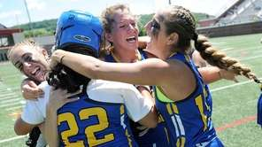 West Islip's Haley Newburg, left, Lauren Distefano (22),