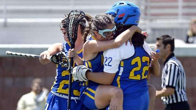 West Islip's Paige Sherlock, left, jumps on goalie