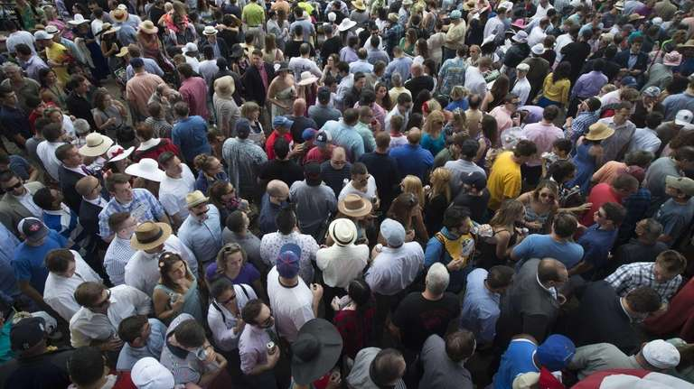 Horse racing fans gather for the 147th running
