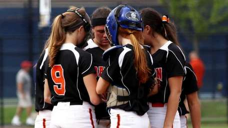 Babylon softball players huddle up during the Class