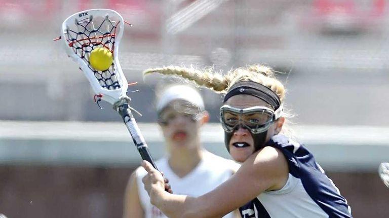 Eastport-South Manor's Kelsey Huff, left, turns toward net