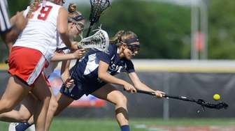 Eastport-South Manor's Allyson Tolken scoops up a loose