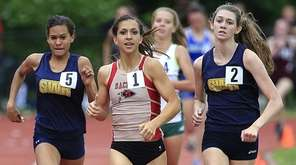 Shoreham-Wading River's Katherine Lee, left, overtakes Sachem East's