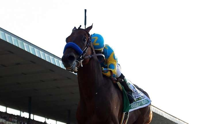 American Pharoah, ridden by Victor Espinoza, comes down