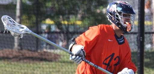 Manhasset's Thomas Clejan brings the ball in play