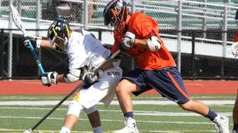 Manhasset's Ben Cirella fights for a ball against