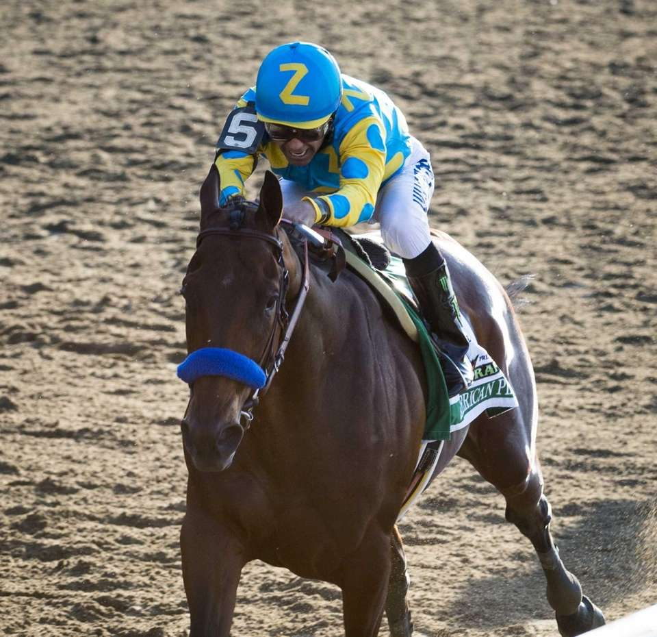 American Pharoah leads the way in the final