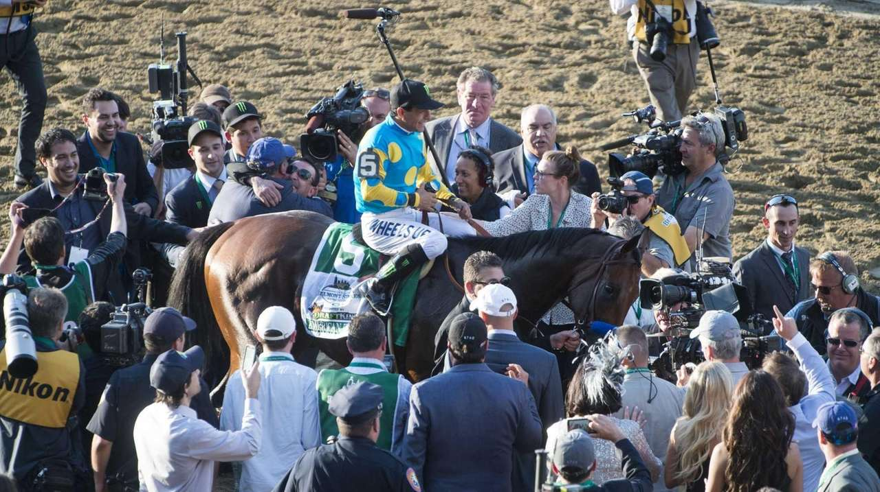 Jockey Victor Espinoza and American Pharoah make their