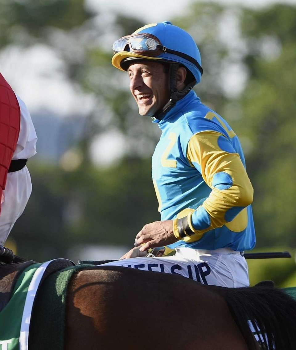 Jockey Victor Espinoza sits atop American Pharoah after