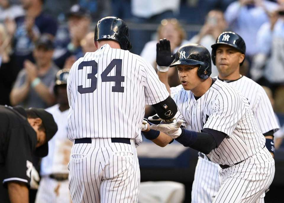 Yankees catcher Brian McCann (34) is congratulated by