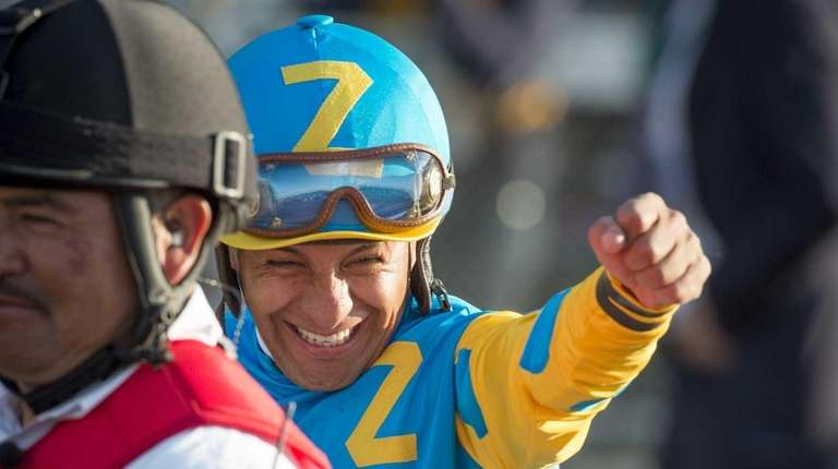 American Pharoah jockey Victor Espinoza waves to the